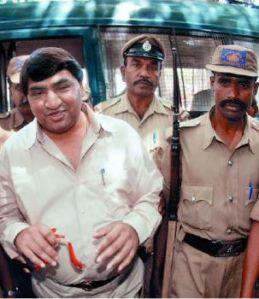 Abdul Karim Telgi, the kingpin of the stamp paper scam, being brought to a Bangalore court in 2003. Telgi underwent narcoanalysis in Bangalore.